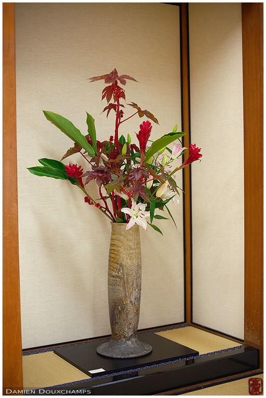 Large standing vase and ikebana