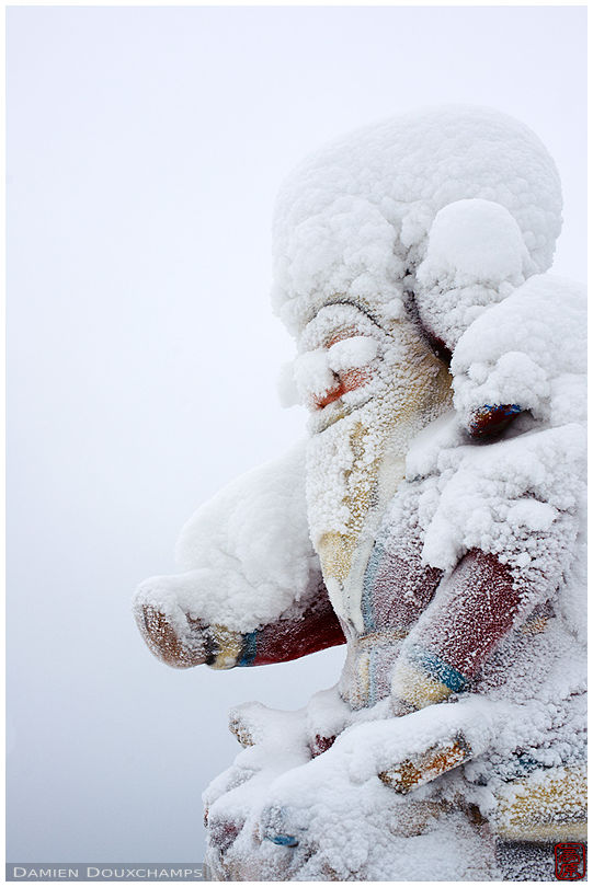 Frost-covered Santa Claus statue in Rovaniemi