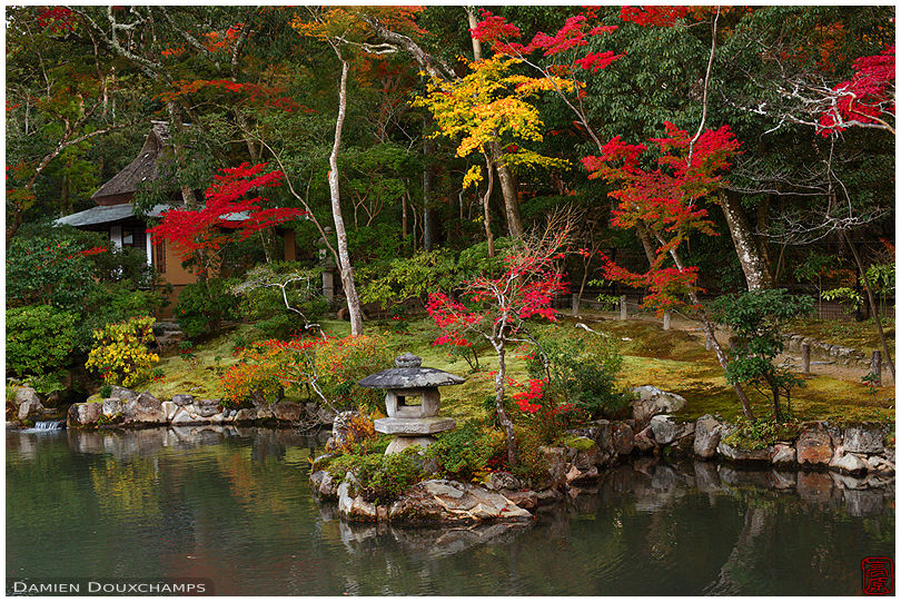 Pond with stone lantern and autumn colours, Isui-en gardens,