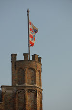 Flag on a small lateral tower of the belfry