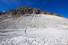 Hiker in the moraines of Ferpecle's glacier