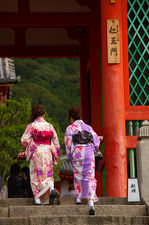 Two young ladies in kimono crossing the main gate