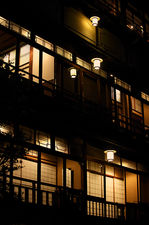 Traditional hotel facade at night