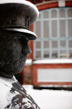 Toripolliisi, a humoristic policeman statue in front of the market halls