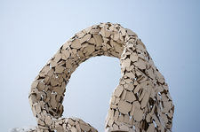 White metallic arch sculpture, Oulu, Finland