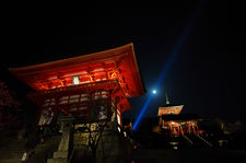 Front gate and pagoda with blue light beam and moon in Kiyomizudera