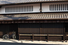 Bicycle in front of a traditional merchant's house, Kyoto