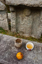 Offerings in front of a jizo statue