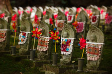 Jizo statues are often offered to temples after a miscarriage or abortion and therefore represent very young children