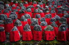 Old jizo statues with red bibs, Risho-in temple, Kyoto