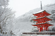 Snow falling on small red pagoda, Kiyomizu-dera temple, Kyoto